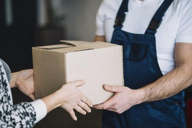 crop-woman-receiving-parcel