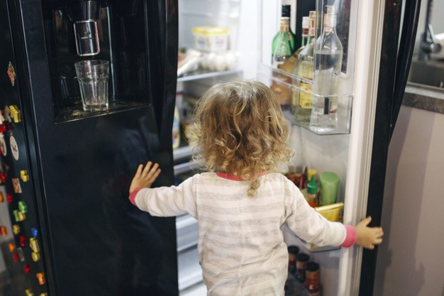 girl-looking-inside-fridge
