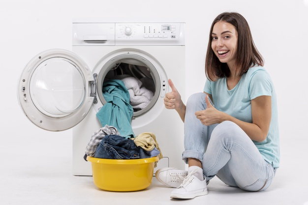 happy-woman-showing-washing- machine