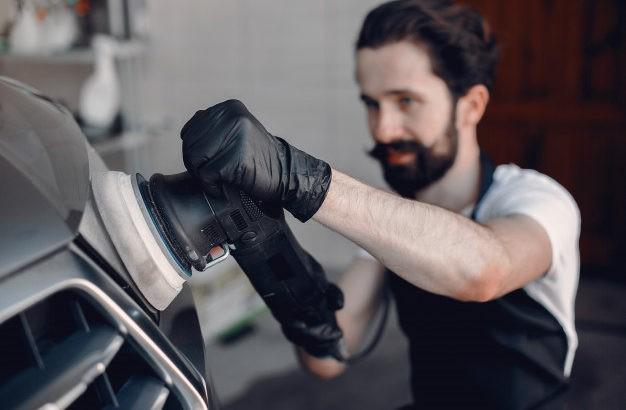 man-polish-car