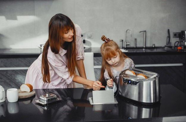mother-with-daughter-kitchen-toaster
